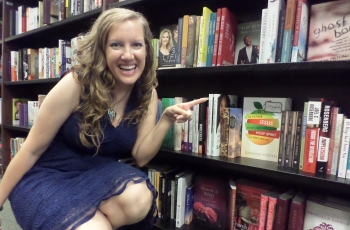 Sunshine Rodgers pointing her book at Barnes and Noble